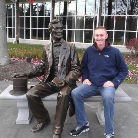 Mr. Licata, a former social studies teacher, and new HMHS administrator, pictured with a statute of Abraham Lincoln.   Photo Credit: Twitter