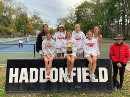 Members of the Girls Tennis team, pictured with Coach Holman, on November 3, 2020.