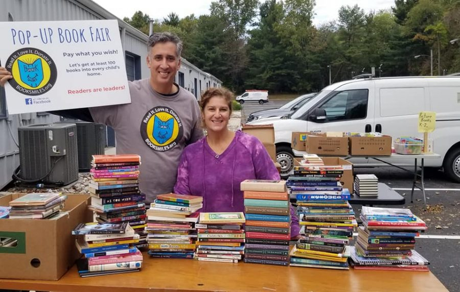 Booksmiles Founder Larry Abrams pictured collecting books to distribute