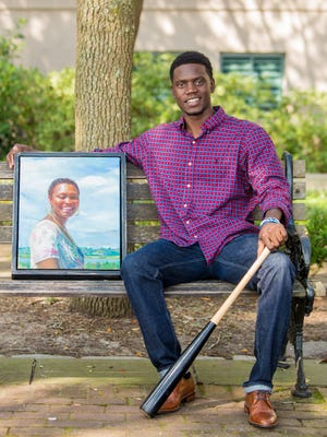 Keynote Speak Chris Singleton featured with a portrait of his mother, who was murdered in a hate crime.