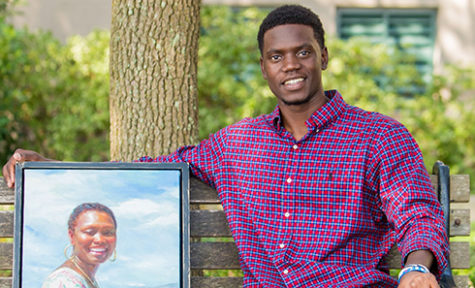 Mr. Chris Singleton with a portrait of his mother, Sharonda Coleman-Singleton, who was one of 9 victims of the Emanuel AME Church shooting on June 17, 2015